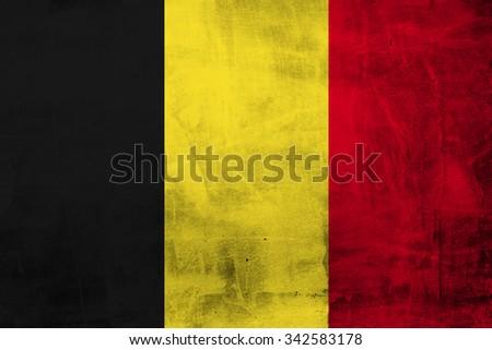 Belgium Grunge Flag on concrete wall - stock photo