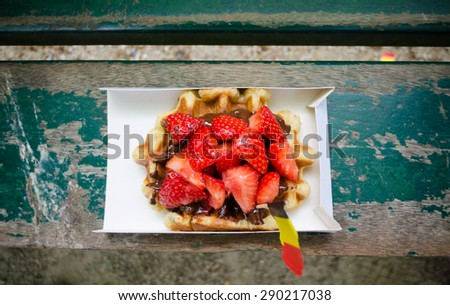 Belgium waffle with chocolate sauce and strawberries. Top view - stock photo