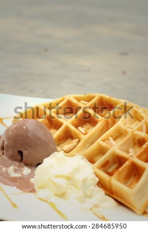 Belgium waffles with ice cream at cake shop.