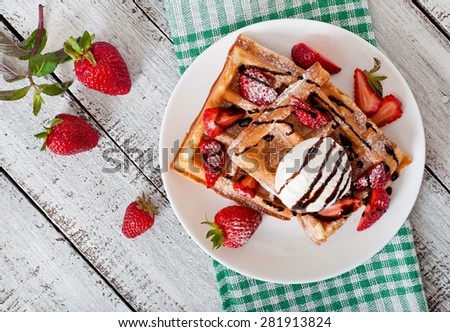 Belgium waffles with strawberries and ice cream  on white plate. Top view - stock photo