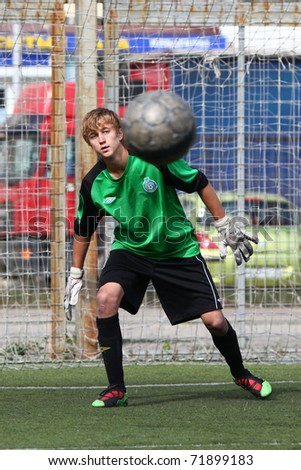 BELGOROD, RUSSIA - AUGUST 26: Unidentified boy plays football as goalkeeper August, 26 2010 in Belgorod, Russia. The is the final of Chernozemje superiority, football team for kids born in 1996. - stock photo
