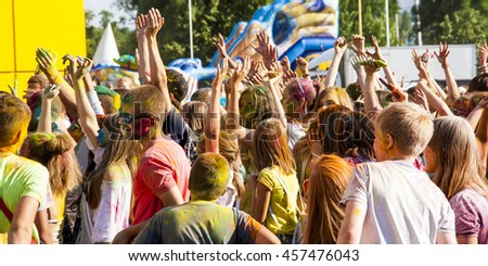 Belgorod, Russia - July 24, 2016: Pretty teen in the festival of colors lift your hands up