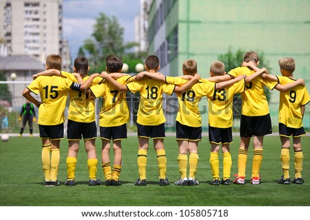 "BELGOROD, RUSSIA - JUNE 17: Unidentified boys from football team ""Elets"" waiting for penalty on June 17, 2012 in Belgorod, Russia. Chernozemie Superiority. Football team of 2001 year of birth. - stock photo"