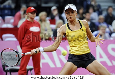 BELGRADE - APRIL 25: Daniela Hantuchova returns the ball to Jelena Jankovic during Fed Cup World Group Play-off  in Belgrade Arena April 25, 2010 in Belgrade, Serbia.