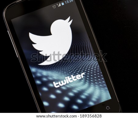 BELGRADE - APRIL 26, 2014 Logo of popular social media website Twitter on smart phone screen - stock photo