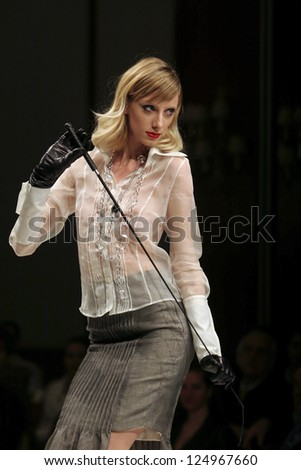 BELGRADE - DECEMBER 2: Model wears a dress from Armando de Vincentiis collection during fashion show December 2, 2007 in Belgrade, Serbia. - stock photo