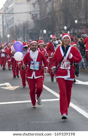"BELGRADE - DECEMBER 29:Participants racing Santa Clauses on "" Belgrade Race Santa Clauses-2013 "",on December 29, 2013 in Belgrade,Serbia."