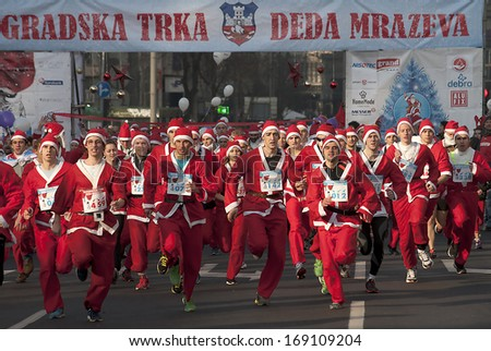 "BELGRADE - DECEMBER 29:Start racing Santa Clauses on "" Belgrade Race Santa Clauses-2013 "",on December 29, 2013 in Belgrade,Serbia.  - stock photo"