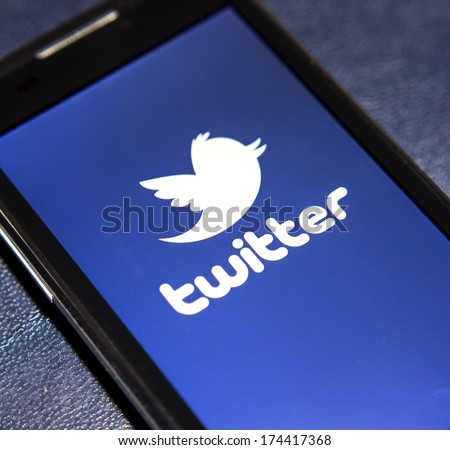 BELGRADE - FEBRUARY 02, 2014 Logo of popular social media website Twitter on smart phone screen - stock photo