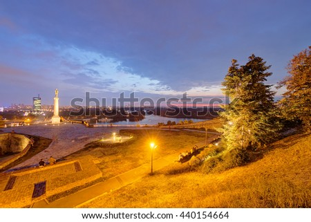 Belgrade fortress and panorama view on victor monument at night - stock photo