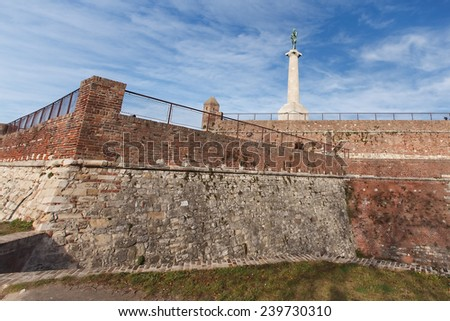 Belgrade fortress and Victor monument. Architecture details of Belgrade fortress with dramatic sky  - stock photo