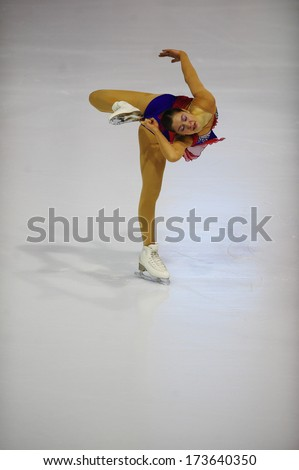 "BELGRADE - JANUARY 25: Finland's Emilia Toikkanen performs free skating at Europa Cup figure ice skating competition ""Skate Helena"" in Belgrade, Serbia on January 25, 2014 - stock photo"