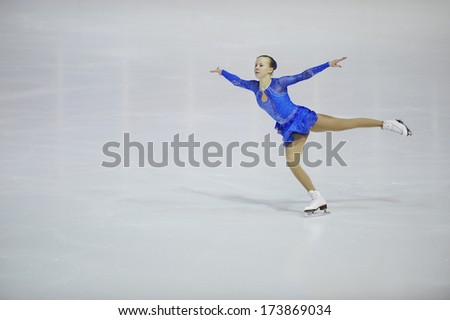 "BELGRADE - JANUARY 24: Finland's Saga Lonnqvist performs her short program at Europa Cup figure ice skating competition ""Skate Helena"" in Belgrade, Serbia on January 24, 2014 - stock photo"