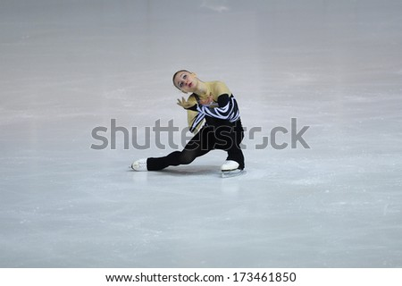 "BELGRADE - JANUARY 23: Italia's Sara Lavagnini performs her free skating program at  Europa Cup figure skating competition ""Skate Helena"" in Belgrade, Serbia on January 23, 2014 - stock photo"