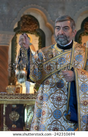 BELGRADE-JANUARY 7.Priest with censer during the Christmas Liturgy in the Temple of Saint Sava in Belgrade.January 7,2015 in Belgrade, Serbia   - stock photo