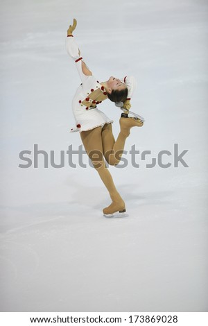 "BELGRADE - JANUARY 24: Serbia's Milica Jokic performs her short program at  Europa Cup figure ice skating competition ""Skate Helena"" in Belgrade, Serbia on January 24, 2014 - stock photo"