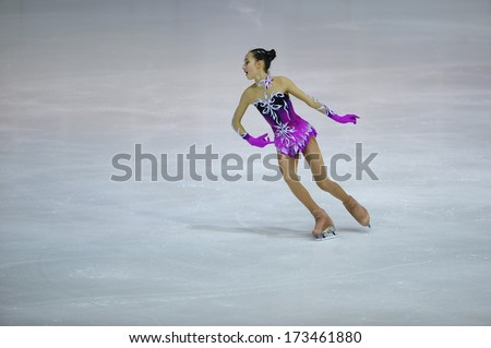"BELGRADE - JANUARY 23: Turkey's Emine Azra Terlemez performs her free skating program at Europa Cup figure skating competition ""Skate Helena"" in Belgrade, Serbia on January 23, 2014 - stock photo"
