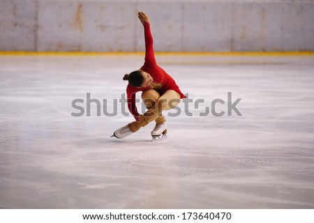 "BELGRADE - JANUARY 22: young girl  performs free skating at Europa Cup figure ice skating competition ""Skate Helena"" in Belgrade, Serbia on January 22, 2014 - stock photo"