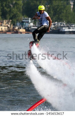 "BELGRADE-JULY 6:Fyboarder Ali Komsusu ( TUR ) during the exhibition on "" Belgrade Boat Carnival-2013"", on July 6, 2013 in Belgrade, Serbia."