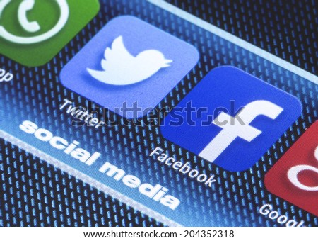 BELGRADE - JULY 11, 2014 Popular social media icons facebook twitter and other on smart phone screen close up - stock photo