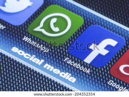 BELGRADE - JULY 11, 2014 Popular social media icons whatsapp facebook and other on smart phone screen close up - stock photo