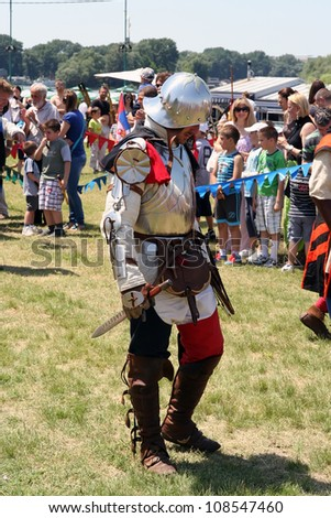 BELGRADE - JUNE 3: An armored spearman on the field at annual Knight tournament on June 3, 2012 in Belgrade, Serbia. - stock photo