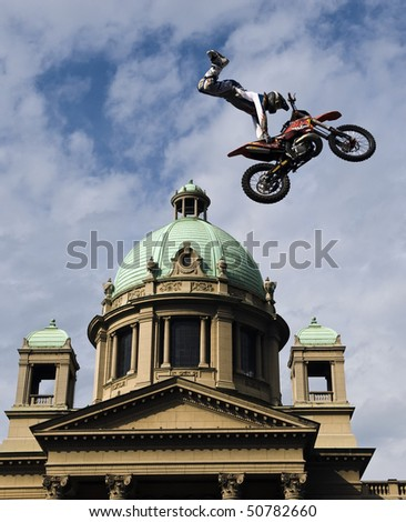 """BELGRADE - MAY 31: Biker jumps during """"Red bull fighters international freestyle motocross exhibition tour"""" May 31, 2009 in Belgrade, Serbia. - stock photo"""