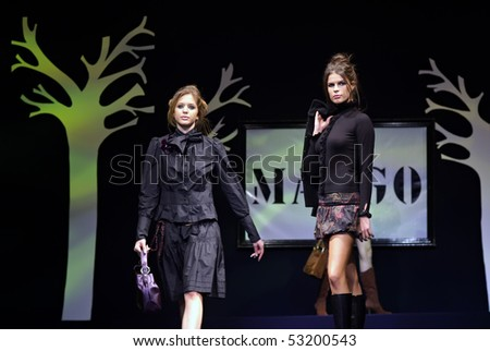 BELGRADE - NOVEMBER 23: Models wear dresses from Mango collection during fashion show November 23, 2005 in Belgrade, Serbia. - stock photo