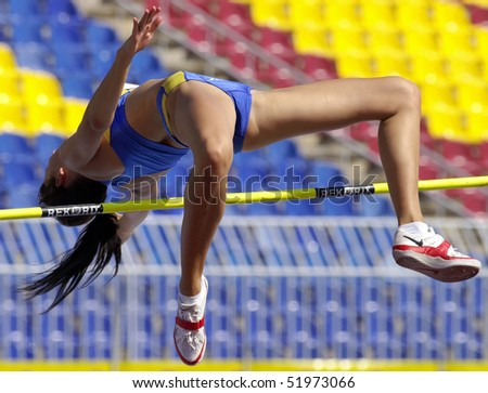 "BELGRADE - SEPTEMBER 17: Athlete is jumping paul vault during ""European champions cup""  September 17, 2005 in Belgrade, Serbia. - stock photo"