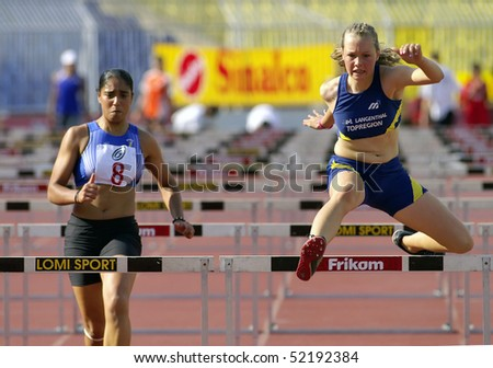 "BELGRADE - SEPTEMBER 17: Athletes are running hurdles during ""European champions cup""  September 17, 2005 in Belgrade, Serbia. - stock photo"