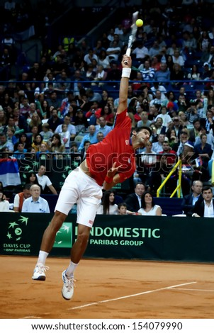 BELGRADE-SEPTEMBER 13:Player N.Djokovic (SRB) served a ball during a match against V.Pospisil (CDN) during semifinal Davis Cup Serbia-Canada.N.Djokovic won 3:0,on September 13,2013 in Belgrade,Serbia - stock photo