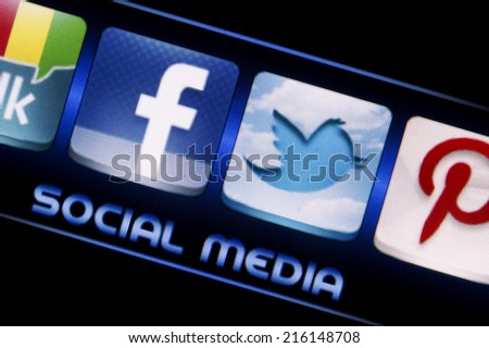 BELGRADE - SEPTEMBER 09, 2014 Social media icons Facebook and Twitter on smart phone screen close up