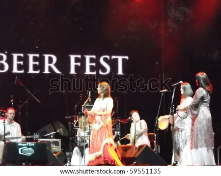 BELGRADE, SERBIA - AUGUST 22: Biljana Krstic and Bistrik orchestra performing on Beer fest, August 22, 2010, in Belgrade, Serbia. - stock photo