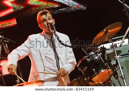 "BELGRADE, SERBIA - AUGUST 20 : ""THE FIRES"", the youngest r'n'r band from Switzerland performs onstage at Belgrade BeerFest 2011 at ""Usce"" August 20, 2011 in Belgrade, Serbia. - stock photo"