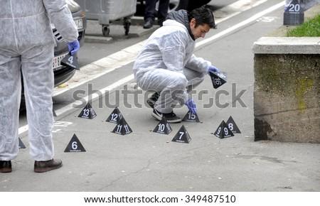 BELGRADE, SERBIA - CIRCA DECEMBER 2015: Crime scene investigators collects ammos and cartridges at crime scene, circa December 2015 in Belgrade - stock photo