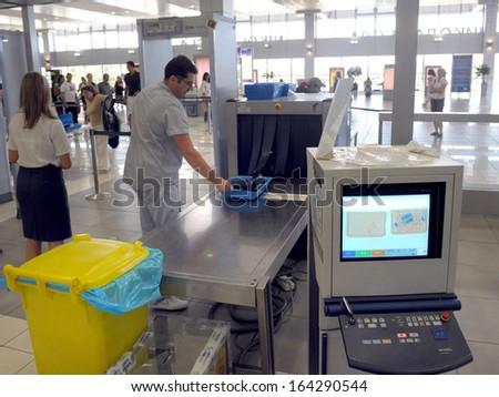 BELGRADE, SERBIA - CIRCA JULY 2009: Passengers passes x-ray check at airport, circa July 2009 in Belgrade - stock photo