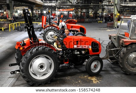 BELGRADE, SERBIA - CIRCA MAY 2013: Workers assembles tractors at tractors and machines factory, circa May 2013 in Belgrade - stock photo