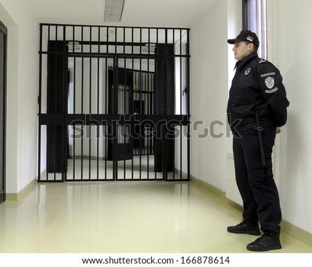 BELGRADE, SERBIA - CIRCA NOVEMBER 2013: Police officers guards bars doors in prison, circa November 2013 in Belgrade - stock photo