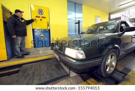 BELGRADE, SERBIA - CIRCA NOVEMBER 2011: Worker inspects vehicle at technical inspection of vehicles center, circa November 2011 in Belgrade