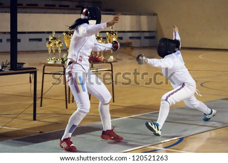 "BELGRADE,SERBIA-DECEMBER1:Fencer Chang Kaitlin(GBR) fight against Undrea Maria(ROU) on the ""57. International Trophy of Belgrade"" Undrea won.December1,2012 in Belgrade,Serbia"