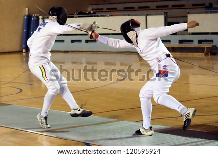 "BELGRADE,SERBIA-DECEMBER1:Fencer Nikolic Danilo(SRB) fight against Arede Pedro(POR) on the ""57. International Trophy of Belgrade"" Nikolic won.December1,2012 in Belgrade,Serbia - stock photo"