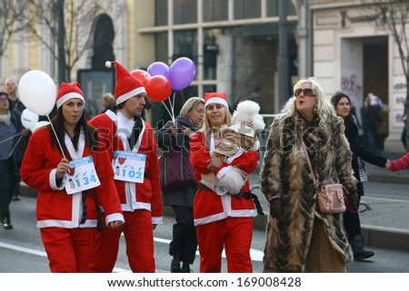 BELGRADE, SERBIA - December 29, 2013: People in Santa Claus costumes take part in the annual race in downtown Belgrade, participating individuals and families, December 29, 2013, in Belgrade, Serbia