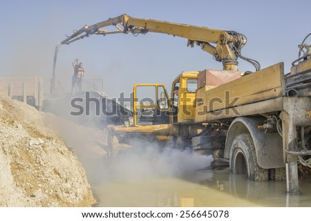 BELGRADE, SERBIA - FEBRUARY 16: Pumping concrete into concrete formwork. At construction site in February 2015.
