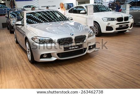 Belgrade, Serbia - March 19, 2015: BMW 5er presented at Belgrade 52nd International Motor Show - MSA (OICA), press day.  - stock photo