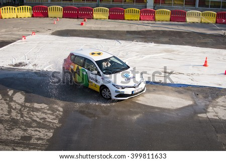 Belgrade,Serbia - March 20,2016. Navak car driving school presentation of safety driving on special track covered with water. Drive safe. Reduce speed.