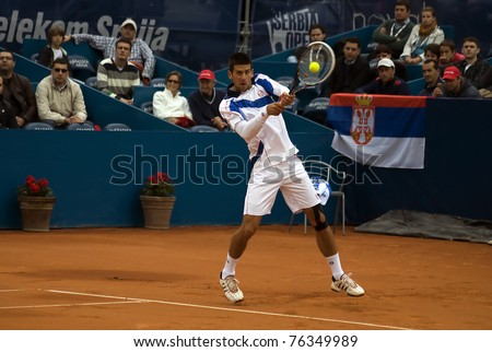 "BELGRADE, SERBIA-MAY 1: Novak Djokovic (SRB) returns a ball during the final match with Feliciano Lopez (ESP) at ""2011 Serbia Open"" on May 1, 2011 in Belgrade, Serbia. Djokovic  win 2:0."
