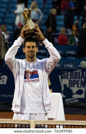 BELGRADE, SERBIA-MAY 1:Novak Djokovic(SRB) with the tournament trophy after final match with Feliciano Lopez(ESP) during 2011 Serbia Open on May 1,2011 in Belgrade, Serbia. Djokovic win 2:0. - stock photo