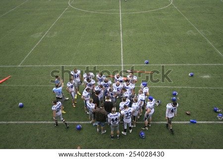 Belgrade, Serbia - May 05, 2014: Team Blue Dragon in the common embrace. American Football Match Between Belgrade Wolves And Blue Dragon in Belgrade. The Wolves team is winner. - stock photo