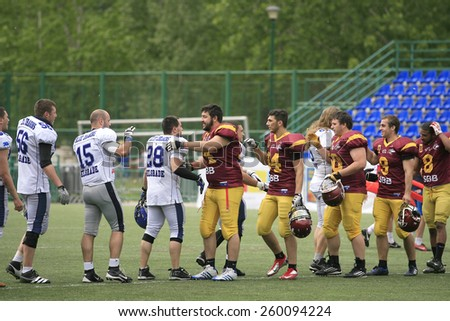 Belgrade, Serbia - May 05, 2014: Teams are welcome among themselves. American Football Match Between Belgrade Wolves And Blue Dragon in Belgrade. The Wolves team is winner. - stock photo