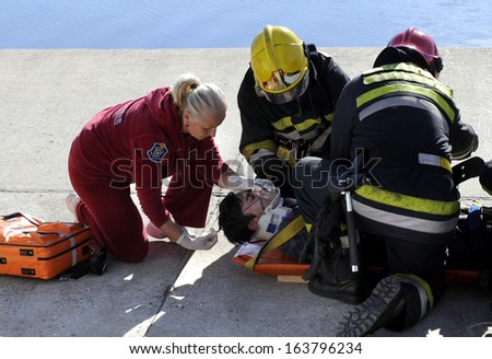BELGRADE, SERBIA - NOVEMBER 6, 2013: Serbian firefighters practices search and rescue operations, November 6 2013 in Belgrade. - stock photo